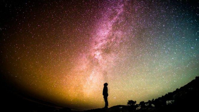 Man staring at stars