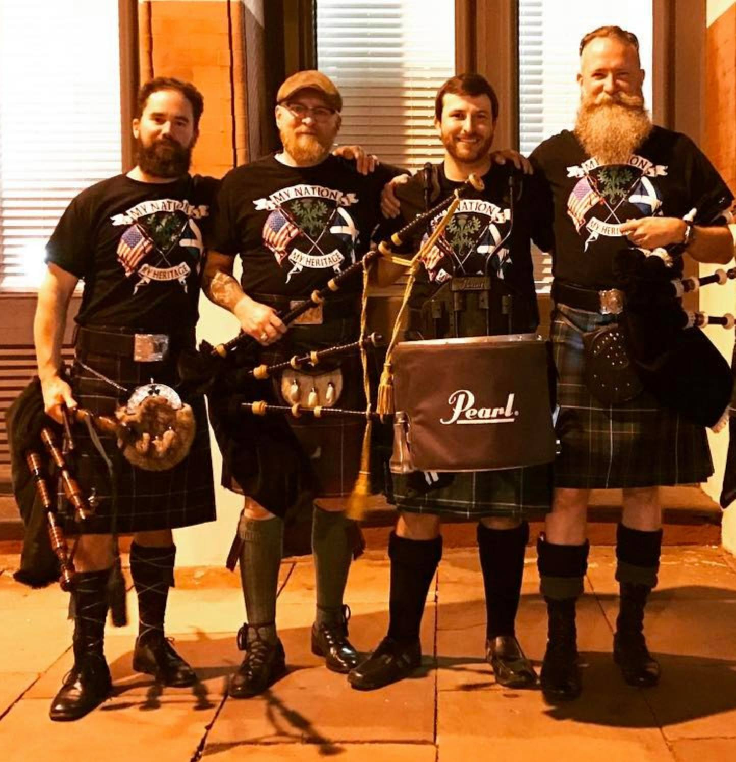 Bobby Hoyt playing drums in a kilt on St. Patrick's Day