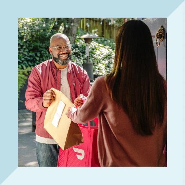 Man delivering DoorDash to a customer.